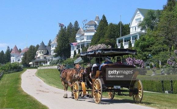 A horse-drawn carriage passes