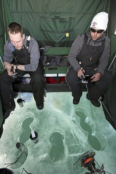 Brad Richgels (left) of Superior, Wis., and Casey Curtis of Silver Bay, Minn., jig for lake trout on Lake Superior on Tuesday afternoon, March 4, 2014, offshore from Duluth. They were among more than 50 anglers or groups of anglers fishing on the lake. (Steve Kuchera / Duluth News Tribune)