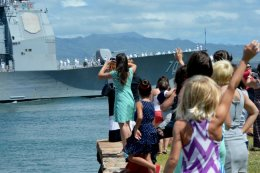 Friends and family members of sailors wave as the guided-missile cruiser USS Lake Erie returned to Joint Base Pearl Harbor-Hickam on Monday from a four-month Western Pacific deployment. (U.S. Navy photo by Mass Communication Specialist 2nd Class Laurie Dexter)