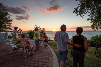 Sunset watchers gather behind the Firehouse Winery at GOTL in July to watch a sunset. The best sunsets on Lake Erie come in the late summer and early fall, when the light is lower and warmer on the horizon, and cold fronts deliver large, dramatic clouds to our doorstep.