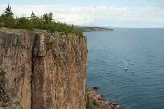 The Freeman's sailing past Palisade Head on north shore of Lake Superior during their journey by water from the Boundary Waters to Washington DC. Photo by: Nate Ptacek @arborealis